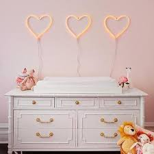 heart shaped marquee lights over white bamboo dresser changing table