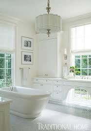 traditional bathroom lighting ideas white free standin. A Freestanding Tub Takes Center Stage In This Sunny, White Bathroom. - Traditional Home ® / Photo: John Bessler Design: Lisa Hilderbrand With Sarah Hamlin Bathroom Lighting Ideas Free Standin B