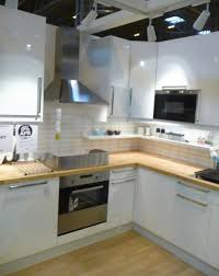 art exhibition replacing kitchen cabinet doors with
