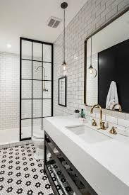 black and white bathroom ideas photos. industrial bathroom with antique brass fixtures, steel and glass shower door cabinet the thickened quartz counter. a finer touch construction black white ideas photos n