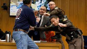Victims' Father Lunges at Larry Nassar ...