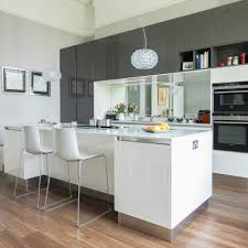 going for an island galley with a breakfast bar is a great idea if you like to as you can cook and entertain at the same time