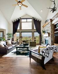 layered cow hide rug sisal rug living room better decorating blog leather couch cathedral ceiling