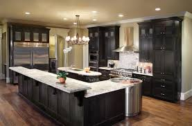 rustic chandelier black stained island kitchen cabinets undermounted sink white marble countertops single hole faucet wall mount stainless steel range hood