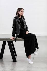 sara donaldson is looking elegant and sophisticated in a black maxi dress paired with a sleek and classic style leather jacket wear this look with white