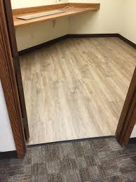 after converted the storage room into a classroom office with mohawk luxury vinyl plank flooring