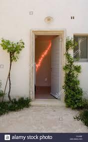 View through open front door to room with Pierre Malphettes artwork