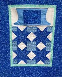 Lovie Lap Quilt with hand  warmers  and pocket -- pattern at  ... & Lap quilt with hand-warmer pocket and regular pocket. Adamdwight.com