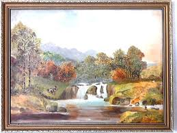oil painting on board depicting landscape in gold frame