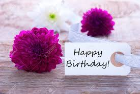 Label With Happy Birthday And Purple And White Flowers Stock Photo