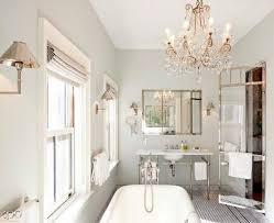 this simple vintage bath is majorly ed up with an antique crystal chandelier