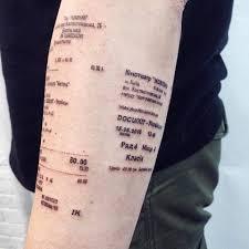 оригинальное тату киевлянин набил на руке чеки кинотеатров фото