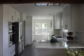 Clean White Kitchen Cabinets And Quartz Countertops