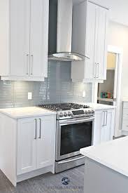 white shaker style cabinets white quartz countertops coventry gray island and stonington gray walls