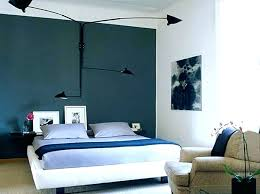 natural stone accent wall behind the headboard makes this bedroom cozier and more inviting cool walls