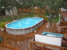 Swimming Pool:Magnificent Oval Shape Above Ground Pools On Wooden Deck  Floor Plus Portable Jacuzzi