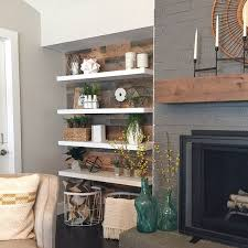 modern floating shelves and a rustic planked wall reclaimed barn wood from paint on the fireplace gauntlet gray by sherwin williams paint on walls