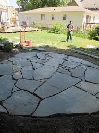 diy stone patio how to install a flagstone with irregular stones diy