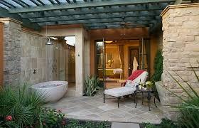... Outdoor bathtub and shower adjacent to the bathroom indoors [Design:  Concreteworks]