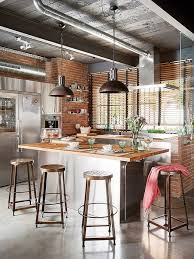 Industrial Loft: This loft in Barcelona assumes a chic industrial style  with exposed brick walls, metallic pipes and copper lighting. (via Decoist)