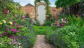 big ideas for small gardens the tiny sus courtyard transformed into a secret garden full of flowers and fragrance
