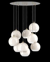 this multi pendant cer chandelier features white and clear hereford globe shades