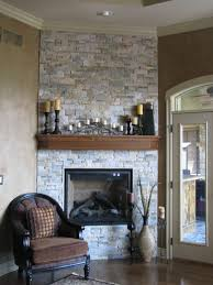 tasteful brick wall exposed with wooden shelves over built in black iron painted fireplace in classic room furniture decorating designs