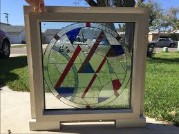 white or tan vinyl framed beveled abstract stained glass window panel