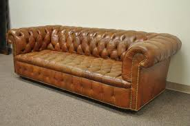 vintage rolled arm english style on tufted brown leather chesterfield sofa by henredon on rolling casters