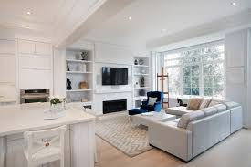 floor lights for living room. an open-concept living room dominated by white. the adjacent eat-in kitchen floor lights for