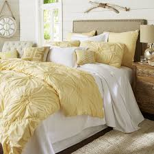 yellow ruched duvet cover with dresser and rug