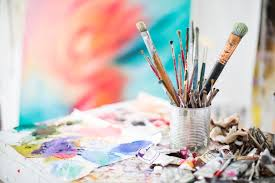 paints and paint brushes in an artists studio