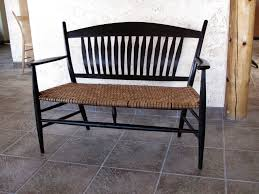 like the chair in the opener this settee features ebonized wood and a woven hickory bark seat
