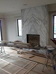 contemporary slab stone fireplace calacutta carrara marble book matched stone slab gas fireplace