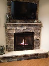 corner fireplace with tv hung above with furniture layout description from com