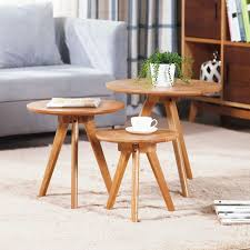 coffee table small round coffee table three wooden tables on the carpet fluffy and white