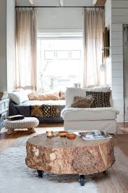 furnitures cozy room with round reclaimed tree trunk coffee table on wheels and white sofa