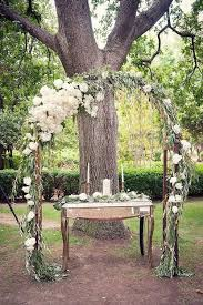 wedding arch ideas decorate with chrisantemums and eucalyptus leaves over a trellis photography
