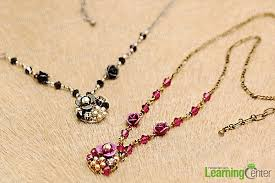 in this tutorial we ll show you a stunning way making your own necklace a long chic and attractive necklace out of glossy pearl beads shimmering crystal