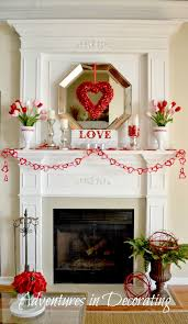 I wanted to share our Valentine mantel before it's time to transition to an  Easter/Spring one.