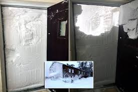 storm emma submerges farmhouse in snow as family open front door to find it pletely blocked