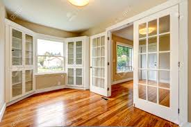 office french doors. Emtpy House With New Hardwood Floor And White French Doors. View Of Entrance Hallway Office Doors