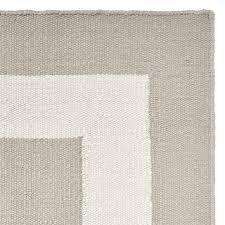solid border indoor outdoor rug plaza taupe