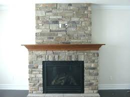 lava rock fireplace mantel stacked stone with white adding a to gas limestone mantels natural veneers rock fireplace