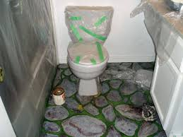 painting a bathroom. grey toilet and hand-painted floor painting a bathroom