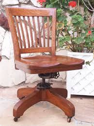 antique bankers oak rolling desk chair 1920s wood casters library industrial