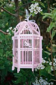 Pretty in pink - our beautiful handmade Lovebird lantern hanging from the  trees