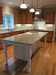 build kitchen island sink: white kitchen island with granite countertop and prep sink island seating for  people at