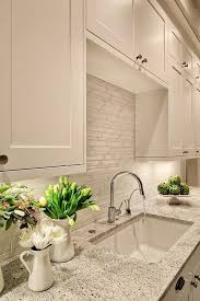 white cabinets look great with such stone inspired grey countertops