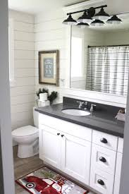 white shaker cabinets with quartz countertops. simple farmhouse christmas bathroom using shiplap, quartz countertops, white shaker cabinets, oil rubbed cabinets with countertops